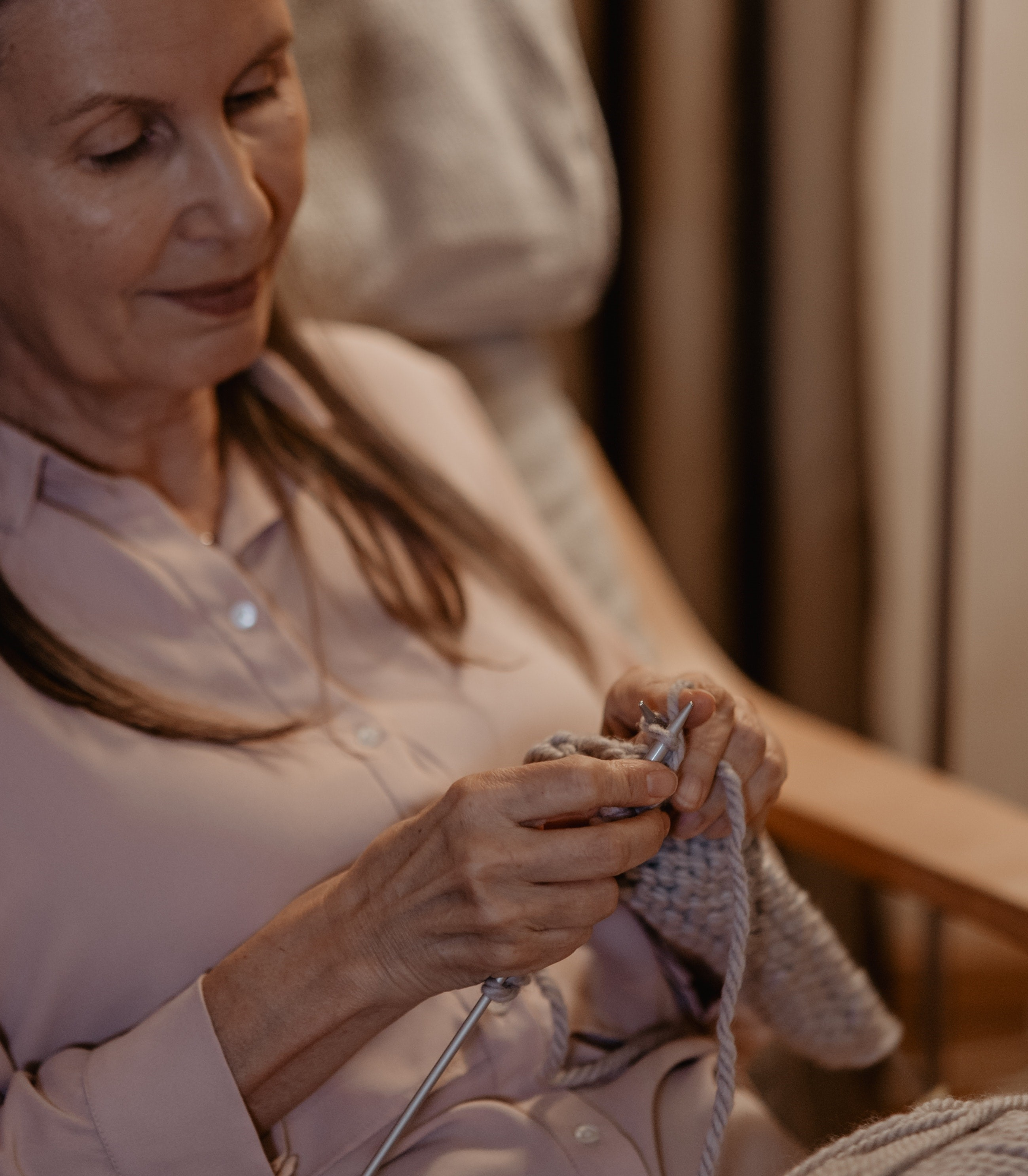 Lady sitting in chair knitting