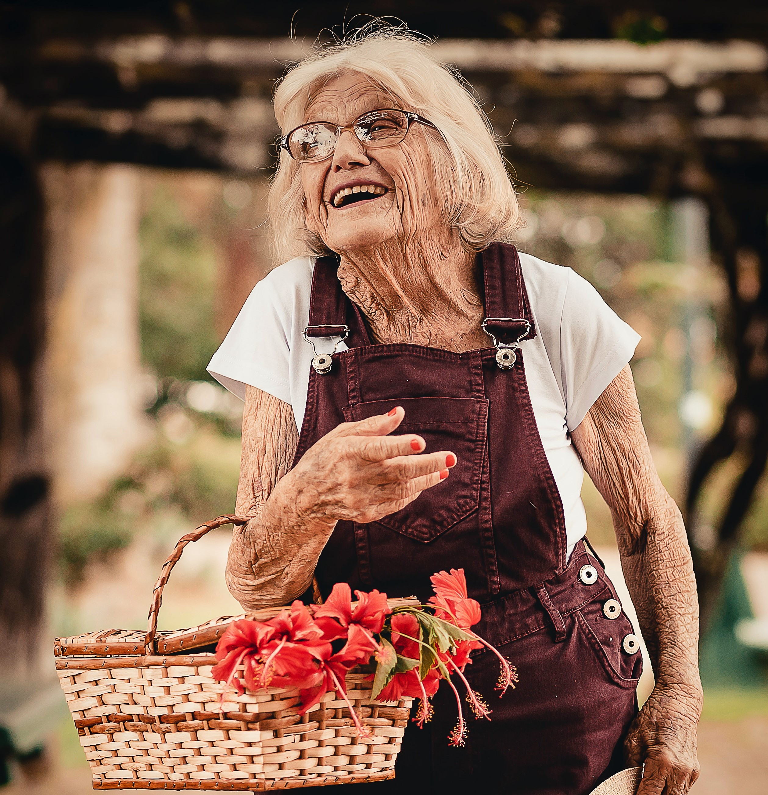 Lady smiling holding basket flowers